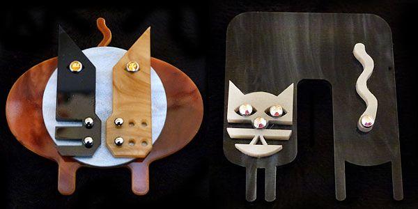 हम किसके साथ भ्रमित हैं: नवदेको द्वारा कला डेको बिल्ली का बच्चा पिन